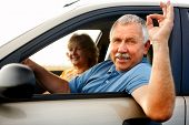 stock photo of car key  - Smiling happy elderly couple in the new car - JPG