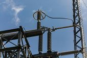 High Voltage Insulators And A Metal Corona Ring, A Corona Ring Or Anti-corona Ring, Towers And Eleme poster