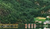 Flam, Norway. Famous Red Wooden Docks In Summer Evening. Small Tourist Town Of Flam On Western Side  poster