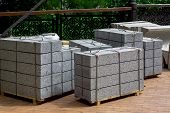 Gray Granite Border Piled In A Pile On A Pallet For Transportation In The Park On Stone Tile, Close  poster