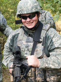 stock photo of army soldier  - The portrait of the smiling US Army soldier with machine gun - JPG