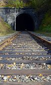 Rail-track leading to the stone tunnel