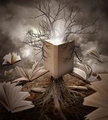 image of surrealism  - A tree with roots is reading a story with books floating around it on a brown old landscape - JPG