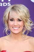LAS VEGAS - MAR 7:  Carrie Underwood arrives at the 2013 Academy of Country Music Awards at the MGM