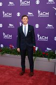 LAS VEGAS - MAR 7:  Scotty McCreery arrives at the 2013 Academy of Country Music Awards at the MGM G