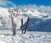Smiling Skier Posing On The Top Of Mountain Pirin