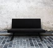 modern sofa on cobblestone street