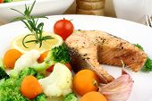 Grilled Salmon Steak And Vegetables On White Plate
