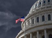 picture of granite dome  - Dark sky over the US Capitol building dome in Washington DC - JPG
