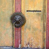 Old lion head door knob, Frymburk, Czech Republic.
