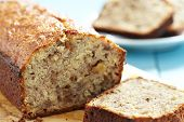 stock photo of walnut  - Sliced banana bread with walnuts - JPG
