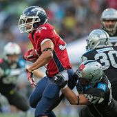 INNSBRUCK, AUSTRIA - JUNE 16 RB DJ Wolfe (#32 Broncos) is tackled by DL Maximilian Pichler (#97 Raid