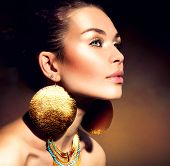 Fashion Woman Portrait. Golden Jewels. Trendy Makeup. Gold Jewellery. Accessories