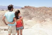 Death Valley tourists people in California enjoying view desert landscape of Zabriskie Point in Deat