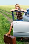 Beautiful Woman With A Suitcase Standing Near A Car
