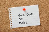 stock photo of debt free  - Get Out of Debt typed on a piece of lined paper pinned to a cork notice board - JPG