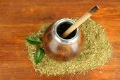 stock photo of calabash  - Calabash and bombilla with yerba mate on wooden background - JPG
