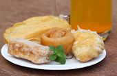 picture of bengali  - Bengali treats named as GOJA on plate with juice - JPG