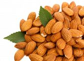 stock photo of edible  - tasty almonds nuts with leaves - JPG