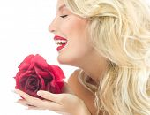 Beauty girl with red rose flower. portrait of attractive caucasian young woman blond, isolated on white , studio shot, face,skin; lips; makeup; long hair;