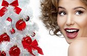 beauty portrait of attractive smiling young caucasian woman christmas tree face closeup skin teeth s
