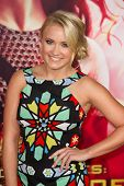 LOS ANGELES, CA - NOVEMBER 18: Actress Emily Osment arrives at the premiere of The Hunger Games: Cat