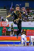 KUALA LUMPUR - NOV 03: USA's Jeffrey Lui performs with a staff in the Men's 'Nangun' Event at the 12th World Wushu Championship on November 03, 2013 in Kuala Lumpur, Malaysia.