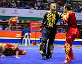 KUALA LUMPUR - NOV 05: Members of Iran's dalian team performs a fight scene in the Men's Dual Event