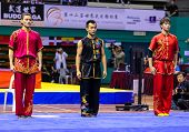 KUALA LUMPUR - NOV 05: Members of Malaysia's dalian team enters the ring for the Men's Dual Event at