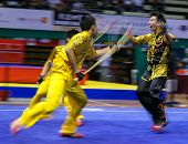 KUALA LUMPUR - NOV 05: Members of Singapore's dalian team performs a fight scene in the Men's Dual E