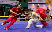 KUALA LUMPUR - NOV 05: Members of Ukraine's dalian team performs a fight scene in the Men's Dual Eve