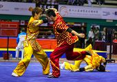 KUALA LUMPUR - NOV 05: South Korea's dalian team performs a fight scene in the Men's Dual Event at the 12th World Wushu Championship on November 05, 2013 in Kuala Lumpur, Malaysia.