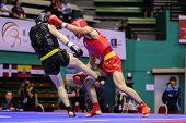 KUALA LUMPUR - NOV 03: Malaysia's Tan Jia Guan (red) fights Sweden's Johan Lindqvist in the Men's 'S