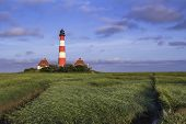 pic of hever  - The Lighthouse of Westerhever at the German North Sea Coast during Sunrise - JPG