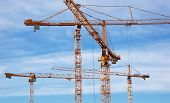 stock photo of heavy equipment operator  - Cranes on a construction site in Stockholm - JPG
