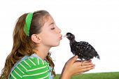 breeder hens kid girl rancher farmer kissing a chicken chick white background