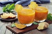 picture of mango  - Mango smoothie in glass with ginger on wooden background - JPG