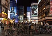 Bicycle Parked In Dotombori District In The Background Of Neon Lights  In Osaka, Japan.