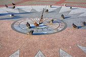 stock photo of sundial  - the Sevastopol. The sundial on granite base