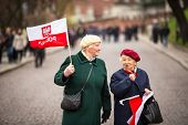 KRAKOW, POLAND - NOV 11: Unidentified participants celebrating National Independence Day an Republic of Poland, Nov 11, 2013 in Krakow, Poland. Is a public holiday, celebrated every year from 1918.