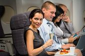 Business travel by airplane woman enjoy refreshment flight cabin passenger