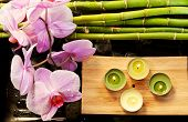 Spa Scene With Pink Orchids, Bamboo And Candles