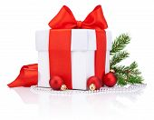 White Gift Box Tied Red Satin Ribbon Bow, Three Christmas Ball And Fir Tree Branch Isolated On White