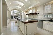image of granite  - Large kitchen in luxury home with curved ceiling - JPG