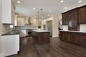 image of granite  - Kitchen in new construction home with center island - JPG