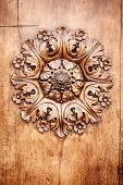 A beautiful wooden rose on a door in Tuscany Italy
