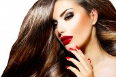 Sexy Beauty Girl with Red Lips and Nails. Provocative Make up. Luxury Woman with Long Brown Smooth H