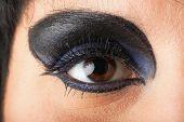 Close up woman. Female eye with black eyeshadow