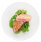Lightly seared tuna steak with sesame and fresh salad isolated on white