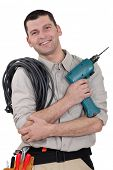Electrician with drill and cable